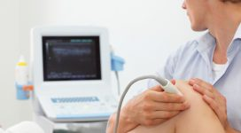 female patient's knee joint dynamic test carried out with the use of an ultrasound